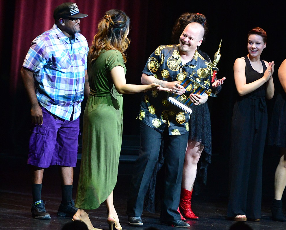 2018 winner Sue Orr presents the first place trophy to Nolan Adair following the finale of the 2019 Prescott Sings Competition Thursday, Sept. 5, 2019, at the Yavapai College Performing Arts Center in Prescott.  (Les Stukenberg/Courier)