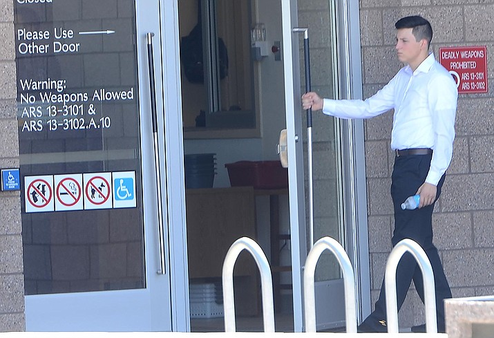 Thomas W. Zielinski enters the Yavapai County Superior Court building Thursday. At his first court appearance since being released from jail on multiple weapons charges, stemming from an incident at Sedona Red Rock High School, Zielinski asked for a public defender. VVN photo/Vyto Starinskas