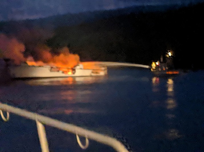 In this Sept. 2, 2019, file photo, provided by the Santa Barbara County Fire Department, firefighters work to extinguish a dive boat engulfed in flames after a deadly fire broke out aboard the commercial scuba diving vessel off the Southern California Coast. The owners of the dive boat where 34 people perished in a fire off the coast of Southern California filed a legal action in federal court Thursday, Sept. 5, 2019, to head off potentially costly lawsuits. Truth Aquatics Inc., which owned the Conception, filed the action in Los Angeles under a pre-Civil War provision of maritime law that allows it to limit its liability. (Santa Barbara County Fire Department via AP, File)