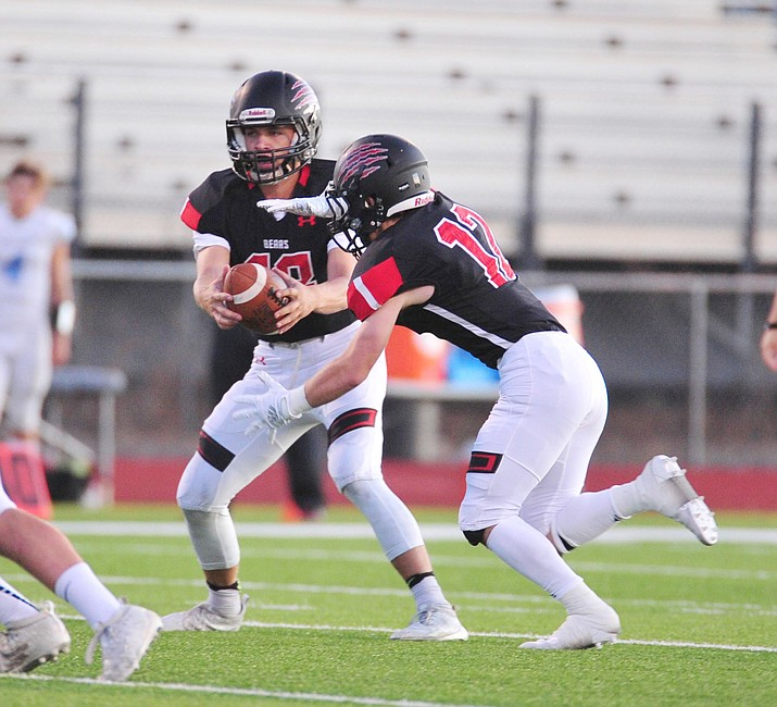 Bradshaw Mountain's Josh Grant hands off to Titus King as the Bears hosted Estrella Foothills in their 2019 football home opener Friday, Aug. 23, 2019, in Prescott Valley. On Friday, Sept. 7, the Bears improved their record to 2-1 with a 24-14 victory over Youngker. (Les Stukenberg/Courier, file)