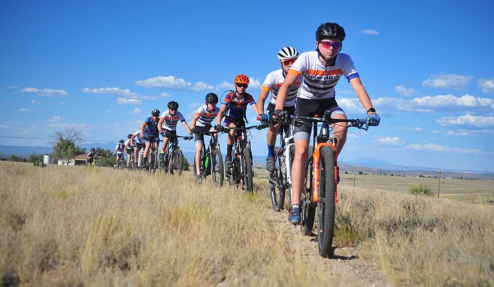 Preston Norbury leads the team as Chino Valley's Arizona Interscholastic Cycling League team practices on State Trust Land, Thursday, August 15, 2019, in Chino Valley. (Les Stukenberg/Courier)