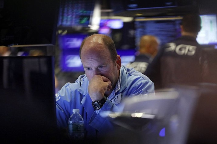 In this Aug. 23, 2019, file photo trader Peter Mancuso works on the floor of the New York Stock Exchange. Stocks tumbled in August, handing the S&P 500 its second monthly loss this year. Investors are unlikely to be able to recoup those losses in September. (Richard Drew/AP, File)