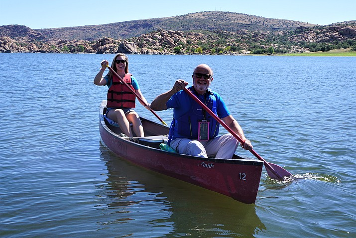 "Prescott resident Lauren Sherwood, left, and Sun City resident Arthur ""Karts"" Huseonica, right, train at Prescott's Watson Lake for a coming ""source-to-sea"" expedition on the Yukon River. The two are looking to set records on the 2,000-mile open-canoe journey. (Cindy Barks/Courier)"