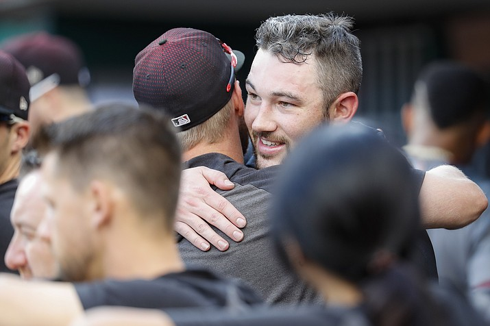 Arizona Diamondbacks starting pitcher Alex Young celebrates in the dugout after closing the eighth inning of a game against the Cincinnati Reds, Saturday, Sept. 7, 2019, in Cincinnati. (John Minchillo/AP)