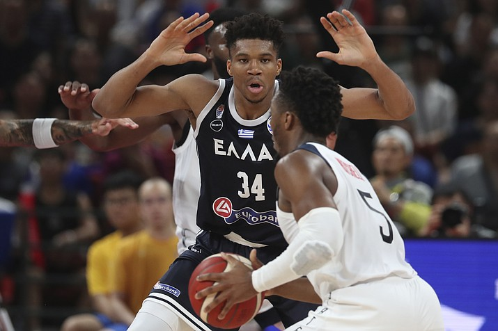 Greece's Giannis Antetokounmpo tries to block United States' Donovan Mitchell during phase two of the FIBA World Cup at the Shenzhen Bay Sports Center in Shenzhen in southern China's Guangdong province on Saturday, Sept. 7, 2019. (Ng Han Guan/AP)