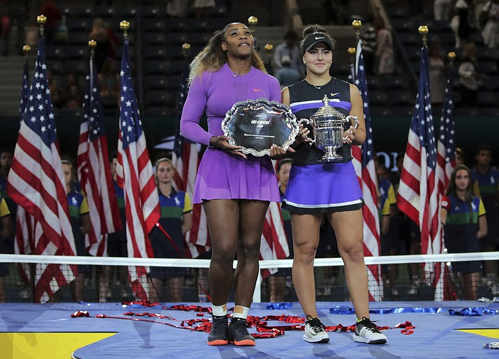 Serena Williams, of the United States, left, and Bianca Andreescu, of Canada, pose for photos after Andreescu won the women's singles final of the U.S. Open tennis championships Saturday, Sept. 7, 2019, in New York. (Charles Krupa/AP)