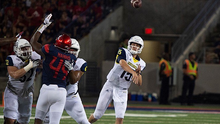 Northern Arizona University quarterback Case Cookus unloads during the Lumberjacks 65-41 loss to Arizona on Saturday. (Northern Arizona University photo)