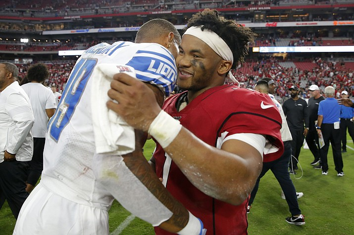 Arizona Cardinals quarterback Kyler Murray, right, greets Detroit Lions wide receiver Kenny Golladay after a game, Sunday, Sept. 8, 2019, in Glendale, Ariz. The Lions and Cardinals played to a 27-27 tie on overtime. (Rick Scuteri/AP)