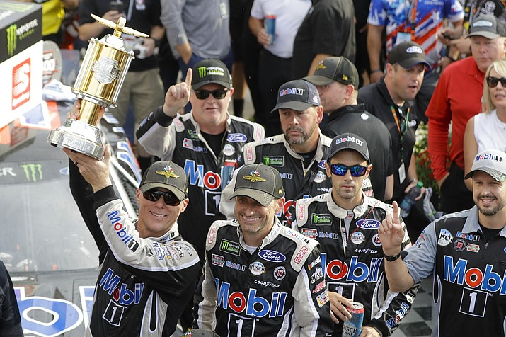 Kevin Harvick, left, celebrates after winning the NASCAR Brickyard 400 at Indianapolis Motor Speedway, Sunday, Sept. 8, 2019, in Indianapolis. (Darron Cummings/AP)