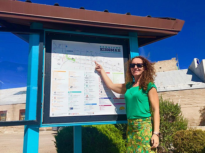 Jasmine Marin of Kingman Main Street was the first person to point at the downtown business map installed the afternoon of Friday, Sept. 6 at the corner of East Andy Devine Avenue and 3rd Street in downtown Kingman. (Photo by Agata Popeda/Daily Miner)