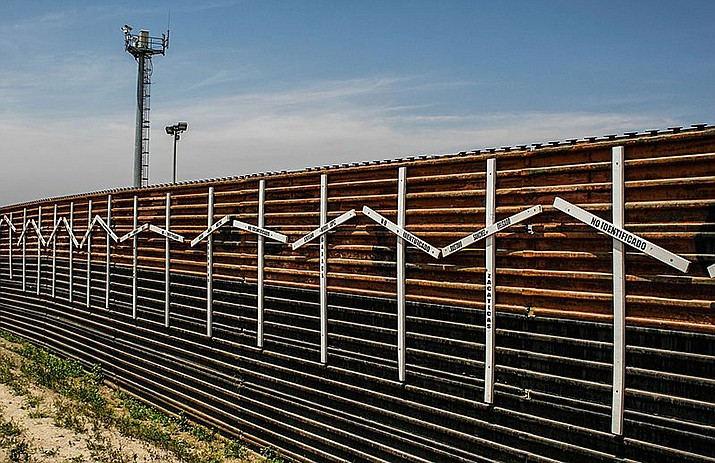 A section of border wall between Mexico and the United States is shown near San Diego. (Photo by Tomas Castelazo, cc-by-sa-4.0, https://bit.ly/2BNhfi2)