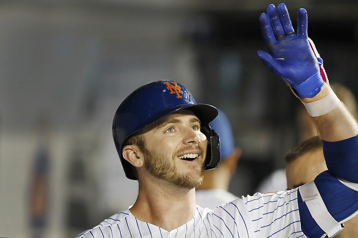 New York Mets' Pete Alonso celebrates in the dugout after hitting a solo home run during the fifth inning of a baseball game against the Arizona Diamondbacks, Monday, Sept. 9, 2019, in New York. It was Alonso's second home run of the game. (Kathy Willens/AP)