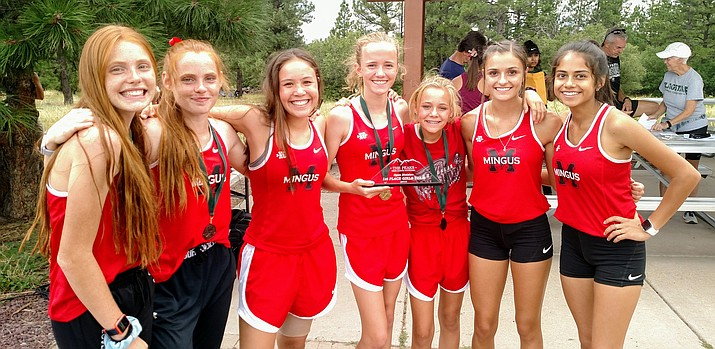 From left: Claire and Aubrey Peterson, Safiya Sweeney, Makena Bliss, Maisie Babcock, Keeleigh Kreiner and Josey Valenzuela with team trophy after dominating performance to win open division of Saturday's Peaks Invitational.