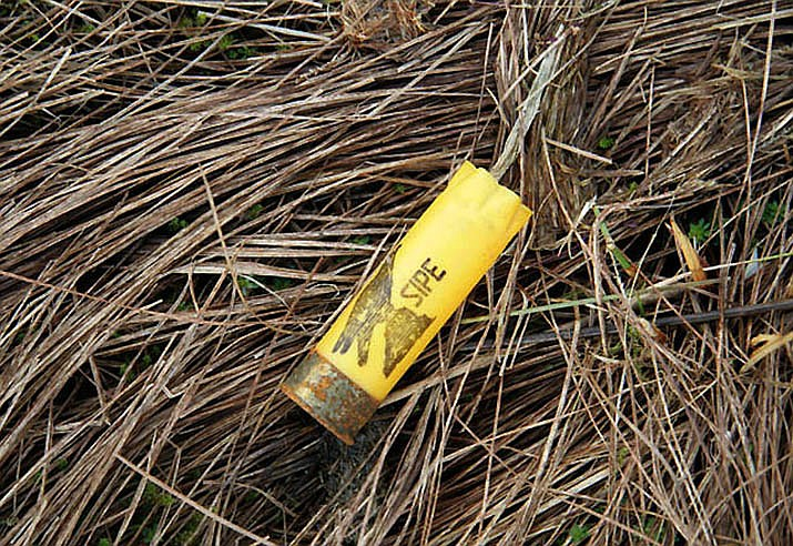 An empty shotgun shell left in the field can result in fines and possible license revocations for hunters. (Photo by Walter Baxter, cc-by-sa-2.0, https://bit.ly/2lHAsMC)