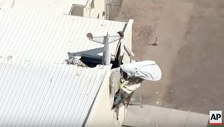 A plane has crashed into a building in Maricopa, Arizona. (AP from video)