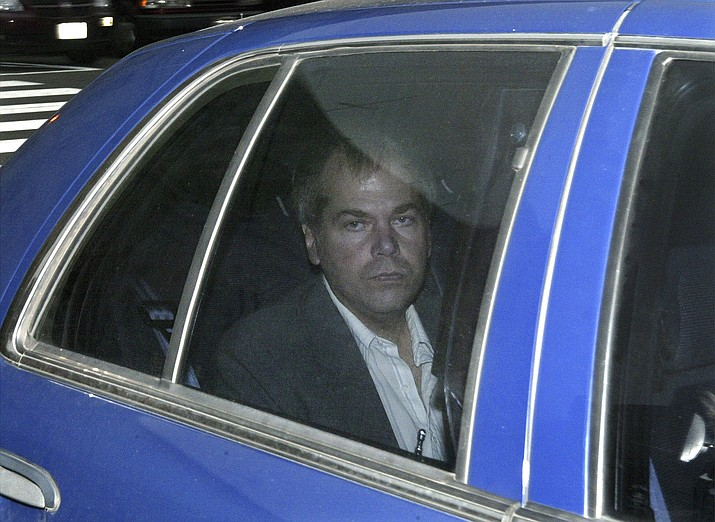 "In this Nov. 18, 2003 file photo, John Hinckley Jr. arrives at U.S. District Court in Washington. The man who tried to assassinate President Ronald Reagan is interested in getting a job in the music industry, possibly in California. That's what a lawyer for 64-year-old John Hinckley Jr. told a judge at a court hearing Tuesday in Washington. But a prosecutor said that would give the government ""great pause."" (AP Photo/Evan Vucci, File)"