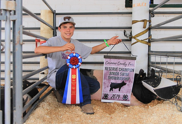 Raymond Gonzalez displays his Reserve Champion Junior Swine Showmanship ribbons at the Coconino County Fair Aug. 31. (Wendy Howell/WGCN)
