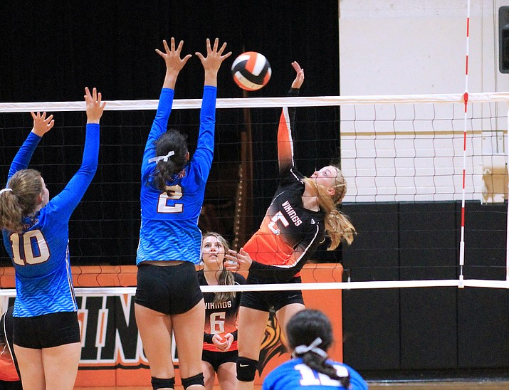 Sydnee Mortensen spikes the ball over two Northland Prep players Sept. 6. (Wendy Howell/WGCN)