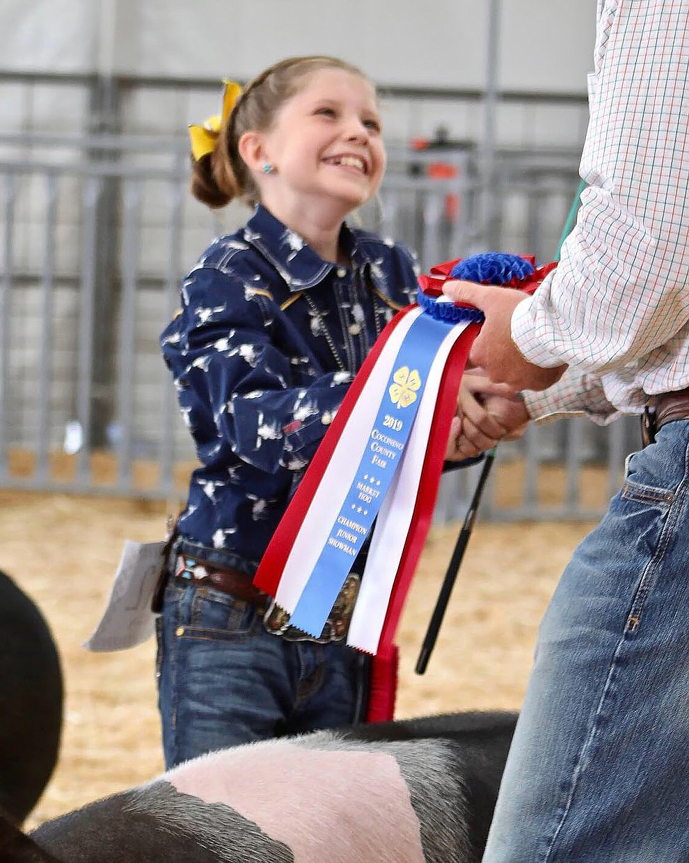 Lauren Westlake receives her Champion Junior Showman ribbon. (Submitted photo)