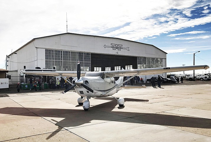 A plane outside the Winslow-Lindbergh Regional Airport's historic hangar during the 2016 Fly-In. (Photo courtesy Old Trails Museum)