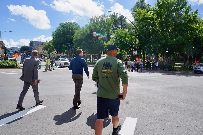 The City of Prescott's kick-off of its pedestrian scramble at the downtown corner of Gurely and Montezuma attracted a crowd Tuesday morning, including a number of city officials. Here, Mayor Greg Mengarelli, left, Tyler Goodman, assistant to the city manager, and others try the new diagonal option. (Cindy Barks/Courier)