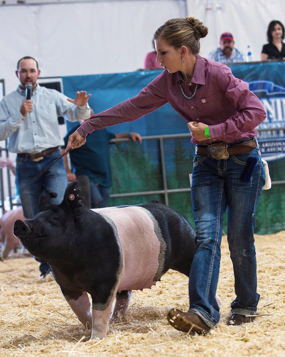 Rebecca Westlake shows her pig at the fair. (Submitted photo)