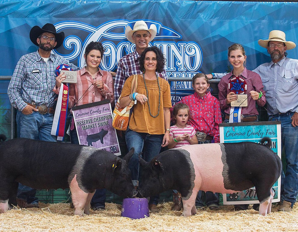 The Westlake family celebrates their wins at the Coconino County Fair Aug. 31. Rebecca Westlake won Grand Champion swine, and Katherine Westlake took home Reserve Champion. (Submitted photos)