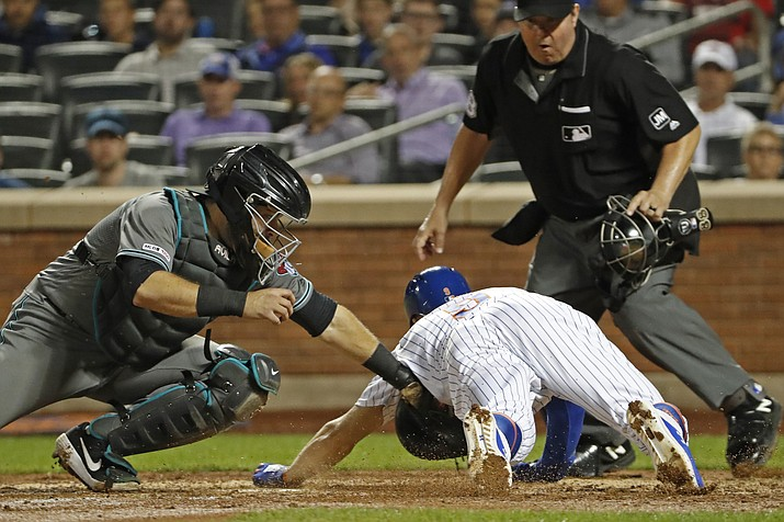 Arizona Diamondbacks catcher Alex Avila tags out New York Mets' Brandon Nimmo at the plate as home plate umpire Doug Eddings watches during the fourth inning of a baseball game Tuesday, Sept. 10, 2019, in New York. (Kathy Willens/AP)