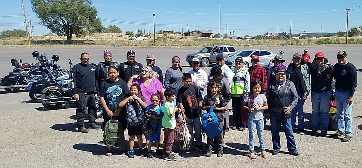 The Navajo Hopi Honor Riders helped give out backpacks in partnership with Running Strong for American Indian Youth. The joint venture helps provide school supplies for youth on the Navajo Nation. (Photo courtesy of the Navajo Hopi Honor Riders)