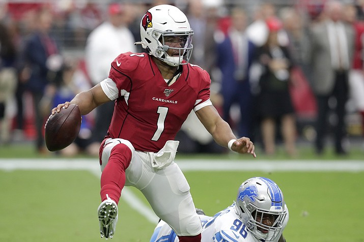 Arizona Cardinals quarterback Kyler Murray (1) tries to elude Detroit Lions defensive end Mike Daniels (96) during the first half of an NFL football game, Sunday, Sept. 8, 2019, in Glendale, Ariz. (AP Photo/Darryl Webb)