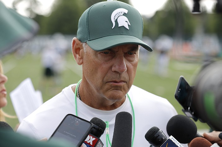 In this Aug. 12, 2019, file photo, Michigan State coach Mark Dantonio talks to reporters during the NCAA college football team's practice in East Lansing, Mich. Michigan State went 7-6 last season and scored only 32 points over its final four games. Even so, the Spartans are ranked 18th in the AP's preseason poll. Although there are plenty of questions surrounding Dantonio's team, it feels like voters decided to give Michigan State the benefit of the doubt for now. (Al Goldis/AP, file)