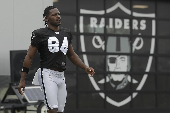 Oakland Raiders' Antonio Brown walks on the field while stretching during practice in Alameda, Calif., Tuesday, Aug. 20, 2019. (Jeff Chiu/AP)