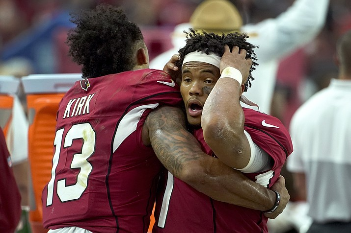 Arizona Cardinals quarterback Kyler Murray reacts with wide receiver Christian Kirk (13) during the final seconds of a game against the Detroit Lions, Sunday, Sept. 8, 2019, in Glendale, Ariz. The Lions and Cardinals played to a 27-27 tie in overtime. (Rick Scuteri/AP)