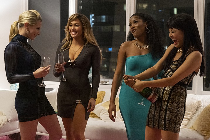 "This image released by STXfilms shows, from left, Lili Reinhart, Jennifer Lopez, Keke Palmer, and Constance Wu in a scene from ""Hustlers,"" in theaters on Sept. 13. (Barbara Nitke/STXfilms via AP)"