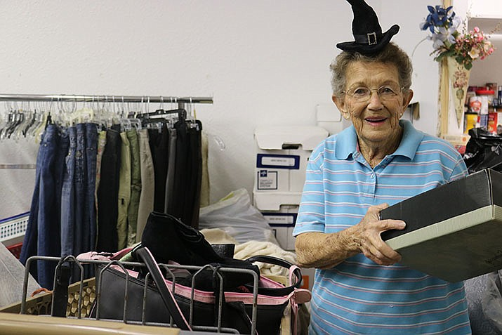 Volunteer Bonnie Wolf is working toward her 15-year pin, which will recognize her 15 years with St. Vincent de Paul when the time comes. (Photo by Travis Rains/Daily Miner)