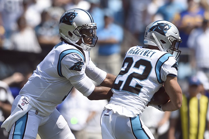 Carolina Panthers quarterback Cam Newton (1) hands off to running back Christian McCaffrey (22) during the first half a game against the Los Angeles Rams in Charlotte, N.C., Sunday, Sept. 8, 2019. (Mike McCarn/AP, File)