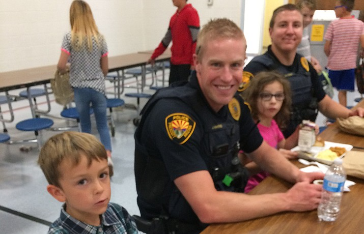 Prescott Police Officers Joe Harris and Andrew Lovan with second-graders Braeden Crouse and Sophia Meza. (Nanci Hutson/Courier)