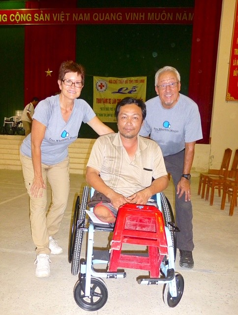 Sue Rubio, left, along with her husband Joe, right, pose for a photo with an unnamed wheelchair recipient in Vietnam. The Free Wheelchair Mission provides wheelchairs to people with disabilities in Third World countries. (Free Wheelchair Mission/Courtesy)