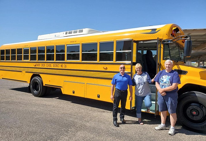 Beaver Creek School District Superintendent Karin Ward, center, shows off her district's new school bus recently, with Frank Villani and Lee Hinson from Canyon State Bus Sales. Photo courtesy Beaver Creek School District