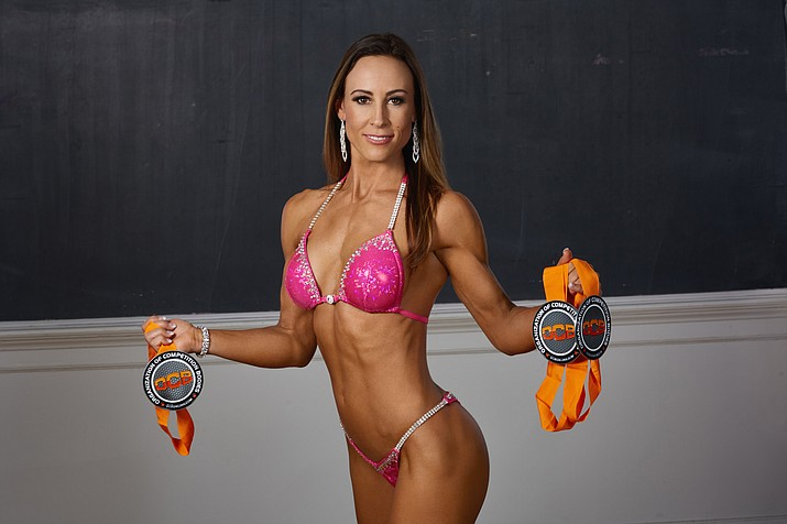 Local personal trainer Erika McClellan won the over 40 division and took ssecond in the novice at the bikini competition at the OCB Slayer Classic in Phoenix. Photo courtesy KFM Designs
