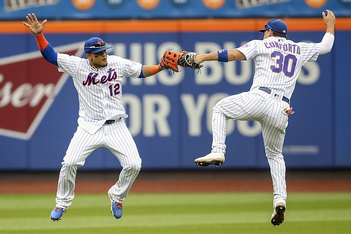 New York Mets' Juan Lagares (12) and Michael Conforto (30) celebrate after defeating the Arizona Diamondbacks during their baseball game, Thursday, Sept. 12, 2019, in New York. (Mary Altaffer/AP)