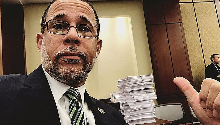 Congressman Anthony Brown points toward a voluminous omnibus spending bill in this file photo. Congress is struggling to pass 12 annual budget bills to fund the day-to-day operations of the goverment. (Rep. Anthony G. Brown courtesy photo)