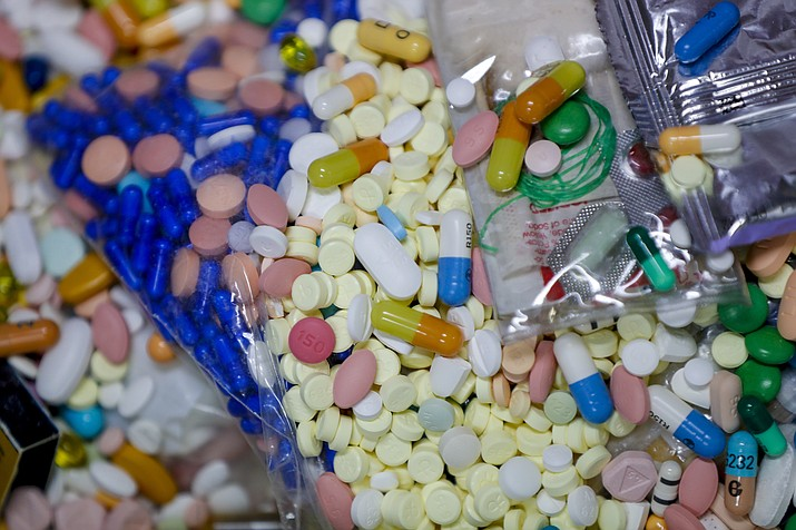 Medications slated for destruction are shown in a locked storage area of the police department in Barberton, Ohio. The tentative settlement involving the opioid crisis and the maker of OxyContin, Purdue Pharma, could mean that thousands of local governments will one day be paid back for some of the costs of responding to the epidemic. (Keith Srakocic/AP, File)