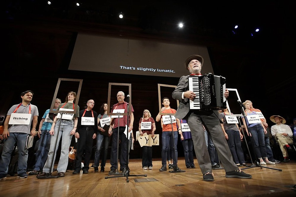 "Dr. Thomas Michael plays the accordion as the ensemble performs, ""The Creatures of Habit Opera"" at the 29th annual Ig Nobel awards ceremony at Harvard University, Thursday, Sept. 12, 2019, in Cambridge, Mass. The spoof prizes for weird and sometimes head-scratching scientific achievement are bestowed by the Annals of Improbable Research magazine, and handed out by real Nobel laureates. (AP Photo/Elise Amendola)"