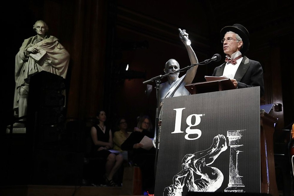Marc Abrahams, far right, presides over the 29th annual Ig Nobel awards ceremony at Harvard University, Thursday, Sept. 12, 2019, in Cambridge, Mass. The spoof prizes for weird and sometimes head-scratching scientific achievement are bestowed by the Annals of Improbable Research magazine, and handed out by real Nobel laureates. (AP Photo/Elise Amendola)