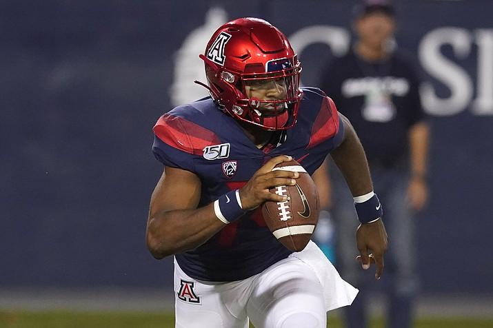 Arizona quarterback Khalil Tate looks down field against Northern Arizona in the second half during a game, Saturday, Sept. 7, 2019, in Tucson, Ariz. (Rick Scuteri/AP)