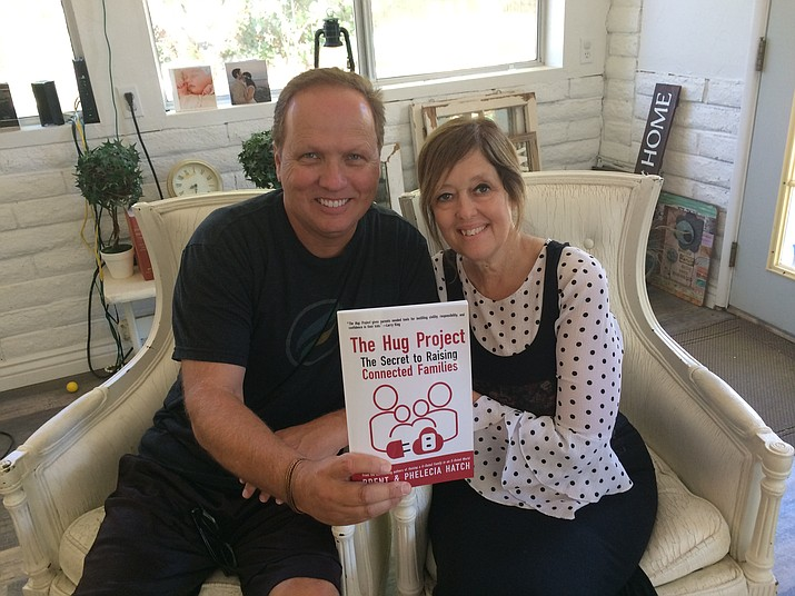 "Brent and Phelecia Hatch, authors of ""The Hug Project – The Secret to Raising Connected Families"" plan to embark on a national tour to share philosophies on parenting they believe can combat other societal ills. (Nanci Hutson/Courier)"
