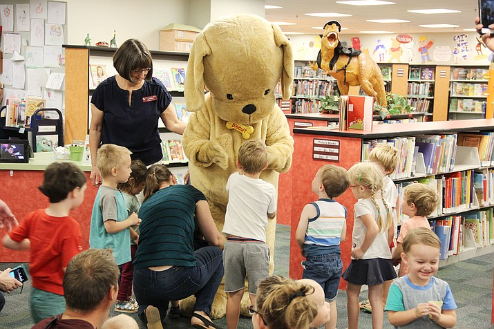 "Children flock to someone dressed as ""Biscuit,"" from the children's book ""Biscuit,"" during the launch event for the Prescott Area Imagination Library at the Prescott Public Library Saturday, Sept. 14, 2019. (Max Efrein/Courier)"