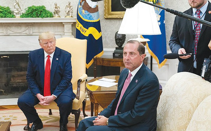 U.S. Health and Human Services Secretary Alex Azar, is shown with President Donald Trump at a White House event to announce a plan to remove flavored e-cigarette products from the market because they are addictive to youth. (White House photo)