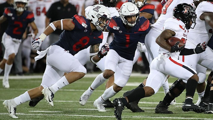 Anthony Pandy (8) and Tony Fields (1) of the University of Arizona Wildcats pursue a Texas Tech ballcarrier during Arizona's 28-14 win on Saturday in Tucson. (University of Arizona Athletic Department photo)